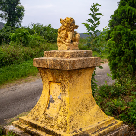 Mismatched Lion and Pedestal
