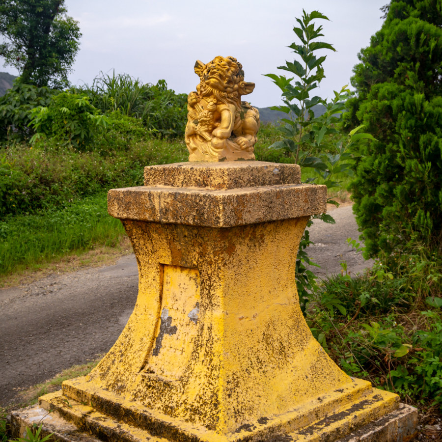 Mismatched Lion and Pedestal