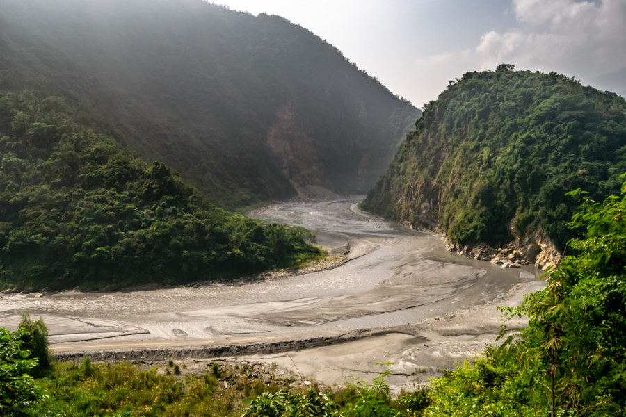 An Abandoned Road Vanishing into a Bend in the Zhoushui River