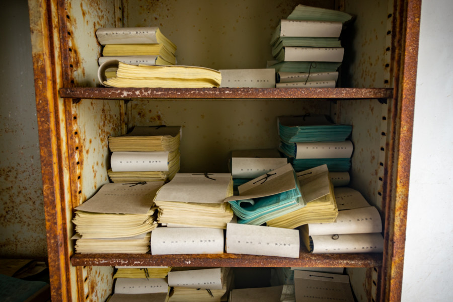 A Cabinet Filled With Logbooks