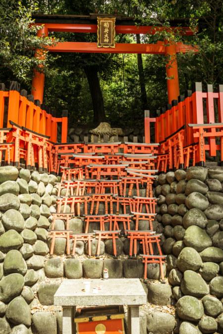 Write your wish on a tiny torii at Fushimi Inari Taisha