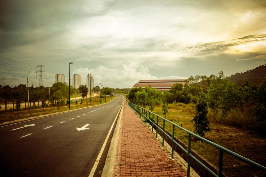 A long walk through a desolate campus at sundown