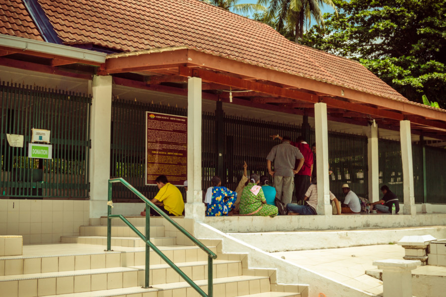 Pilgrims at the most famous tomb on Pulau Besar