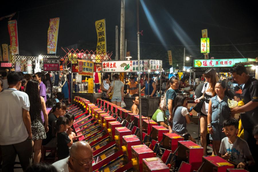 Playing games at Jingcheng Night Market