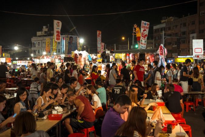 Singing karaoke on top of a truck at Jingcheng Night Market