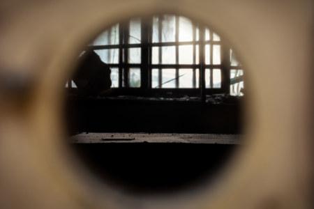 Through a keyhole, darkly