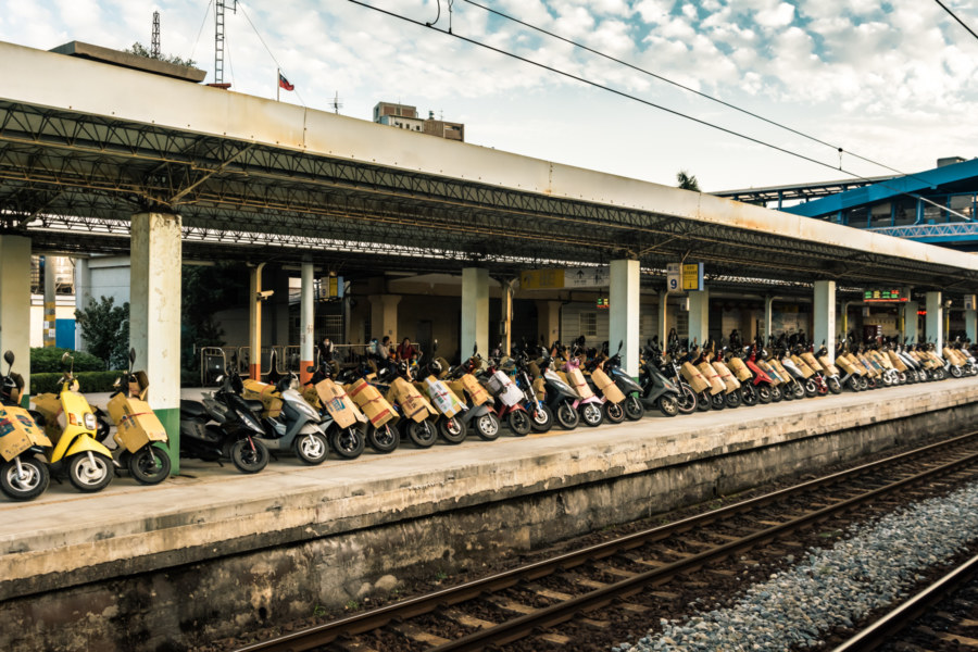 Boxed scooter waiting on the platform at Changhua Station