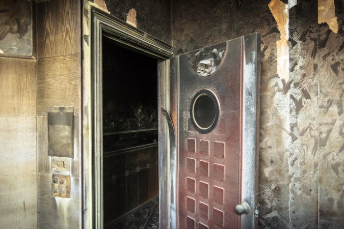 A scorched door at a fire-damaged KTV