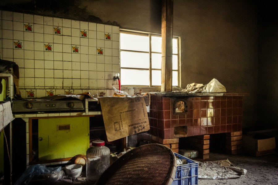 A kitchen in an abandoned home in Dacun township