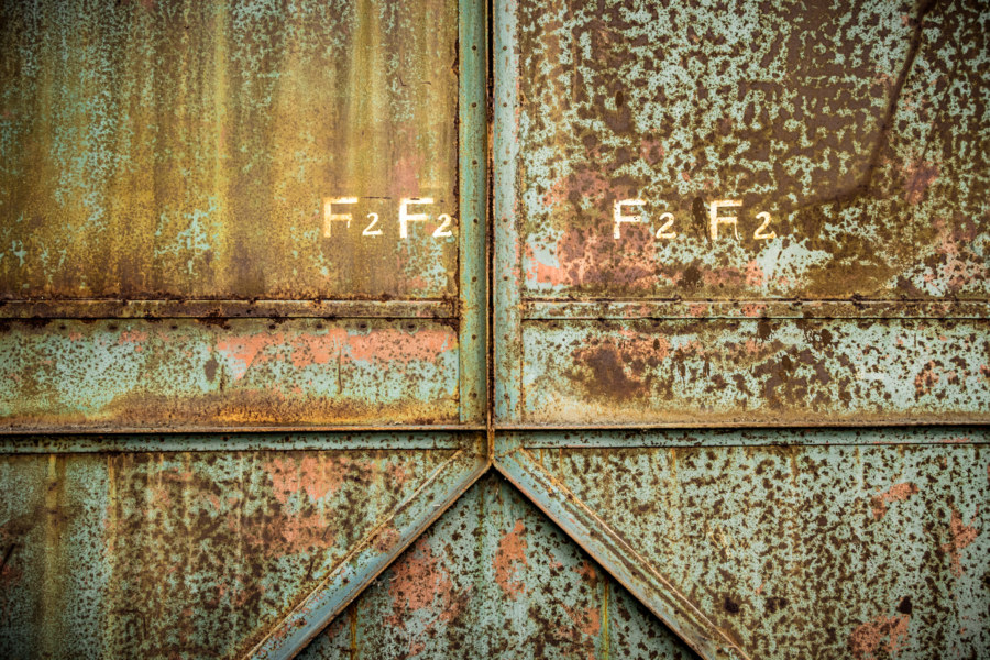 Rusty old door at the abandoned automotive plant