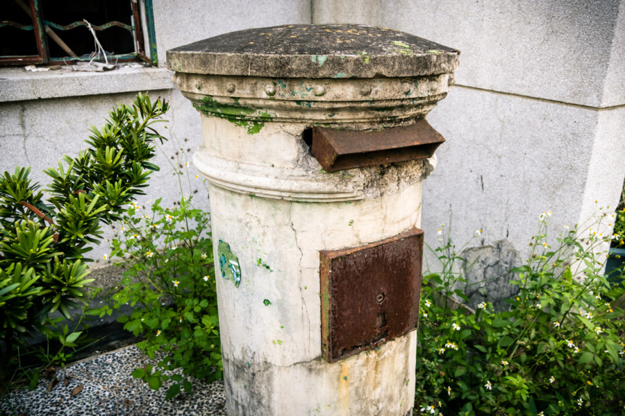 An abandoned post office box in Xizhou