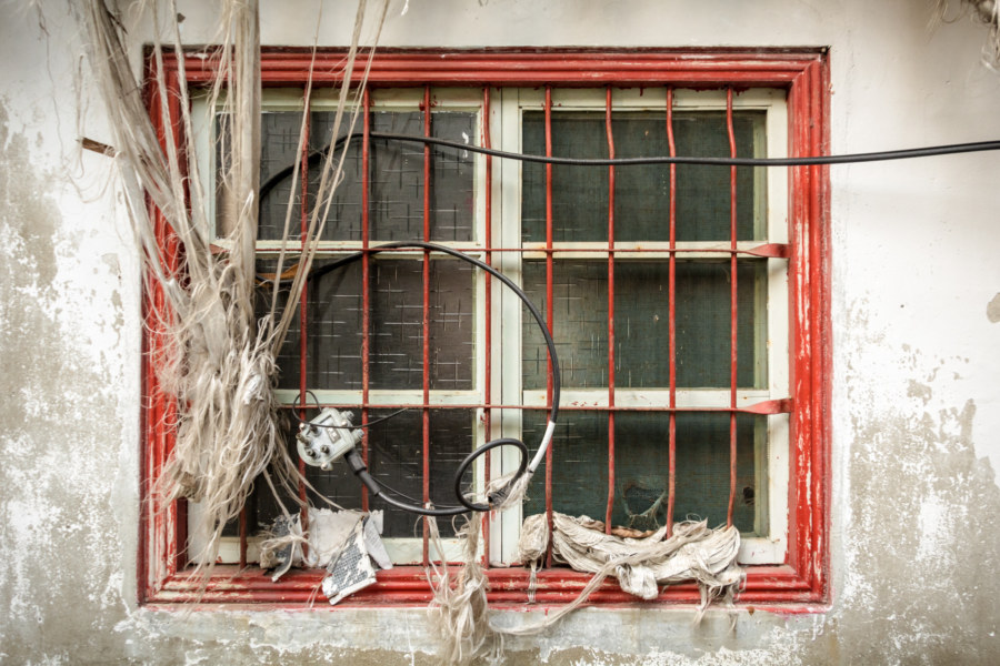 The window of an abandoned home in Zuoying
