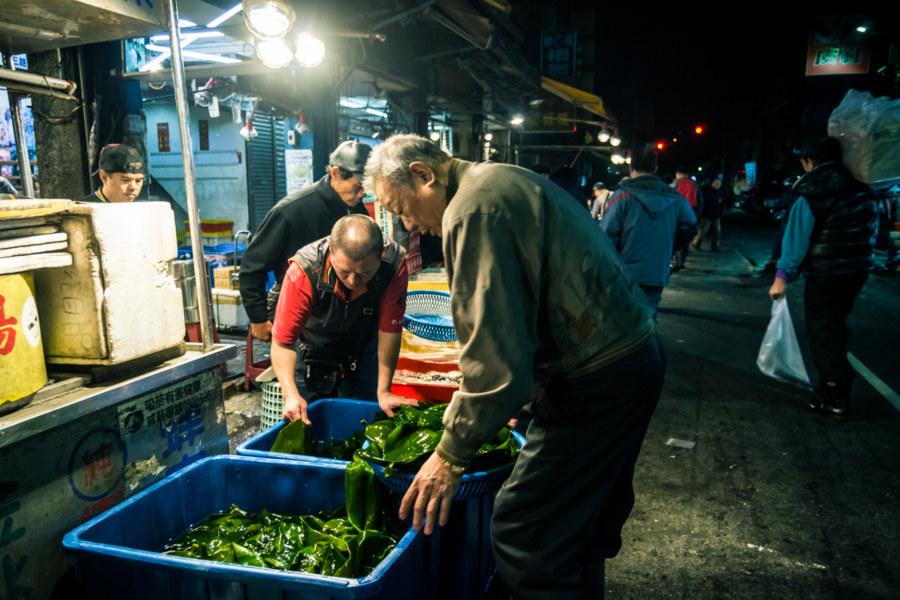 Buckets full of sea vegetables at Kanziding Fish Market