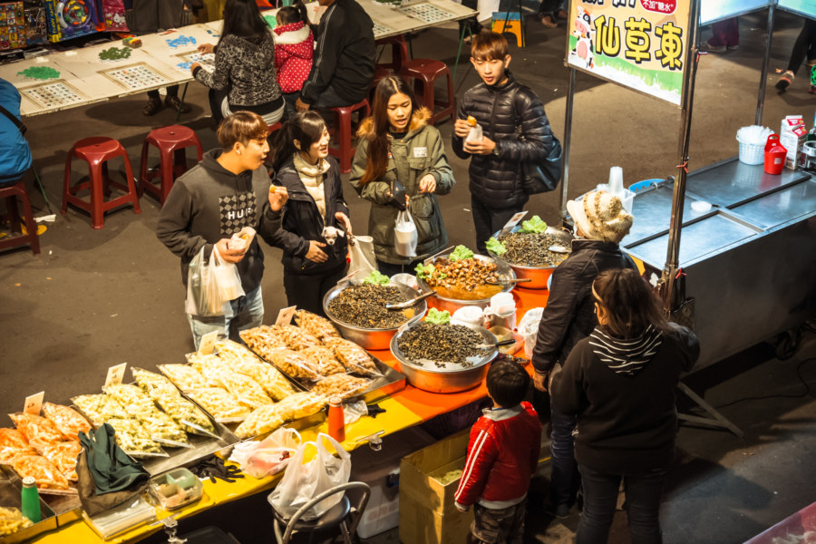 Sampling snacks at Caotun Tourist Night Market
