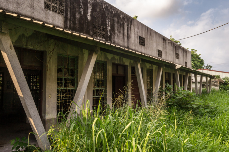 Overgrown courtyard at an abandoned church in rural Pingtung