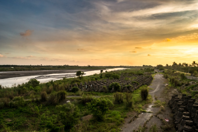 Crossing the Linbian River at sunset
