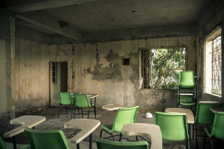 A pile of green chairs in the ruins
