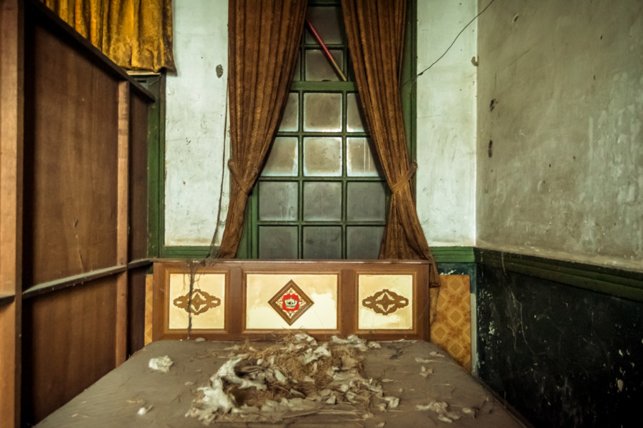Vintage bed inside an old police station in Taichung
