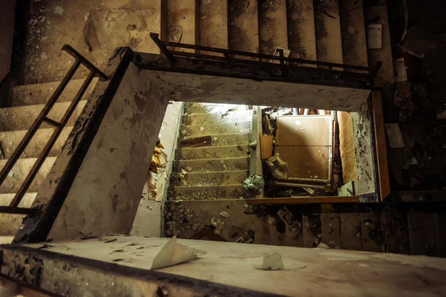 Looking down the stairwell in an abandoned hot springs hotel in