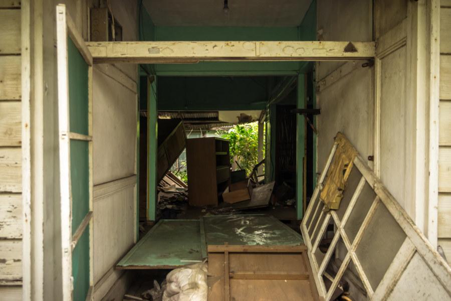 Entering an abandoned home along Civic Boulevard