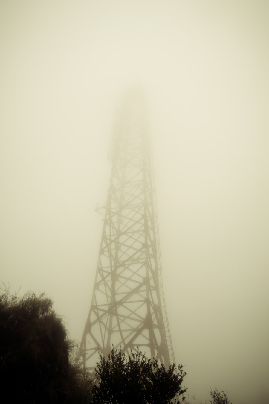 The radio tower above Menghuan pond in the fog
