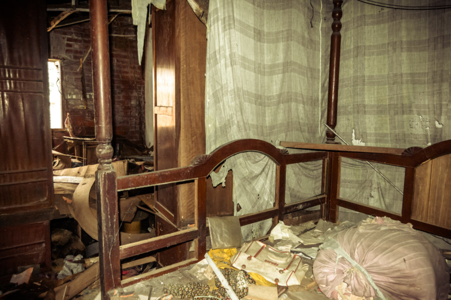 A bedroom in an abandoned home on the edge of Xindian