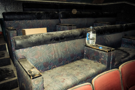 Love seats at the back of the abandoned theater