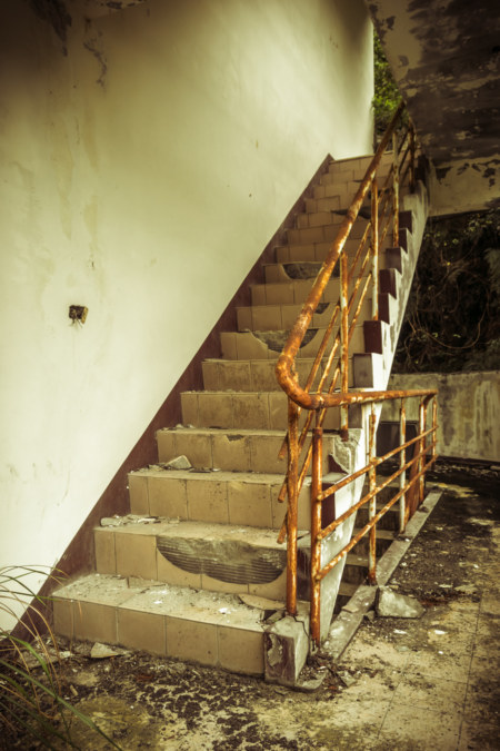 The stairwell at the front of the abandoned hotel