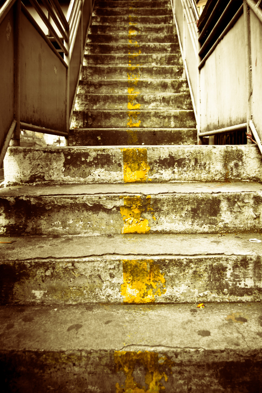 The gritty stairs of a pedestrian overpass