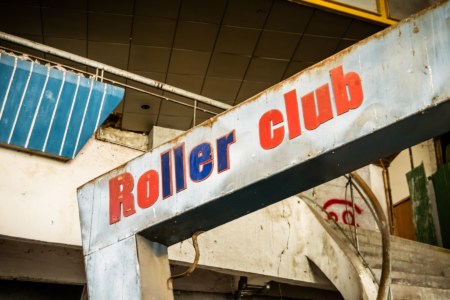 Roller club sign