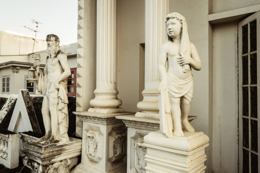 Statues on the balcony at the White Lion House