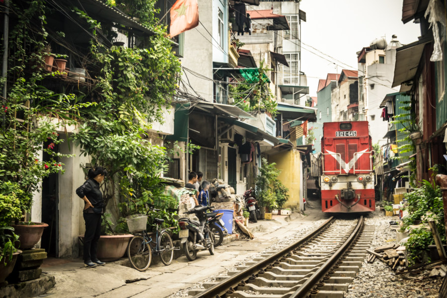 A train rumbles through Hanoi