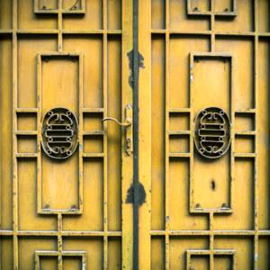 Yellow metalwork on the doors of Hanoi