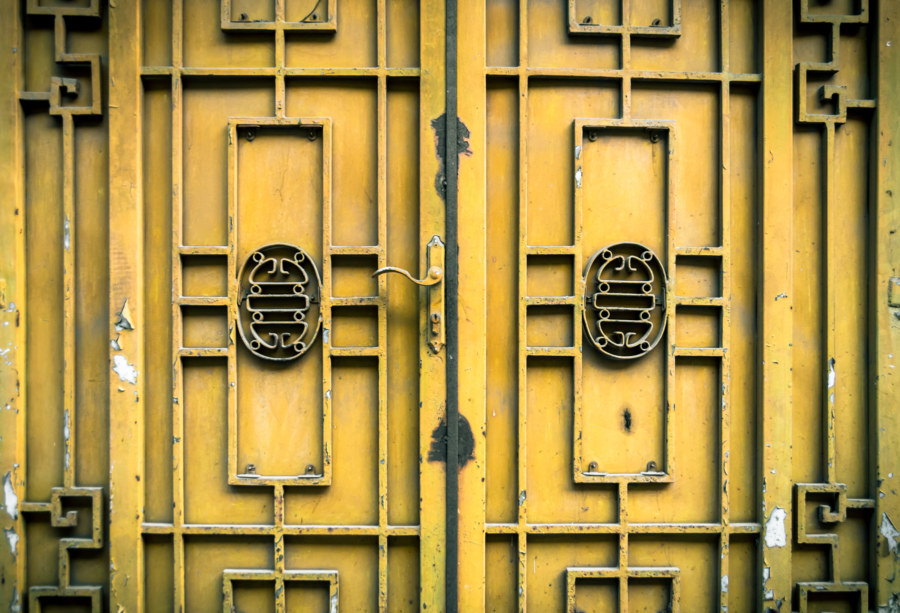 Yellow metalwork on the doors of Hanoi